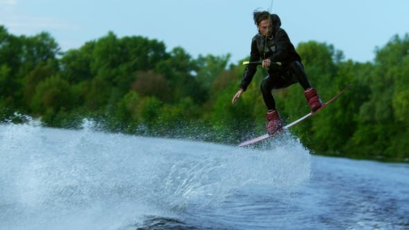 Thumbnail for Man Riding Board on Waves of River Training Process of Waterskiing