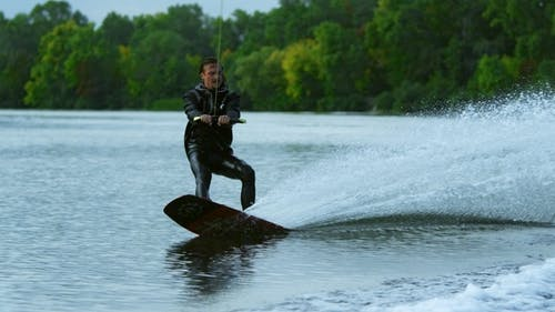 Man Wakeboarding on River. Water Sport Activity