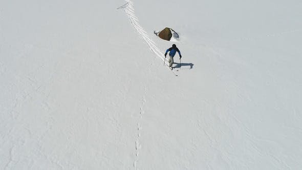 Cover Image for Skier Walking in the Snowy Summit Mountains