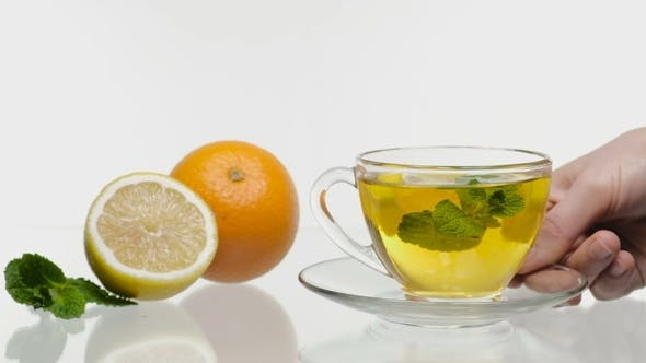 Thumbnail for Fresh and Cold Ice Tea with Sliced Lemon and Mint