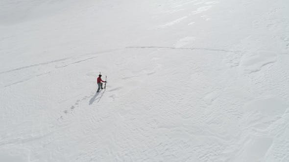 Thumbnail for Skier Hiking to Mountain Summit