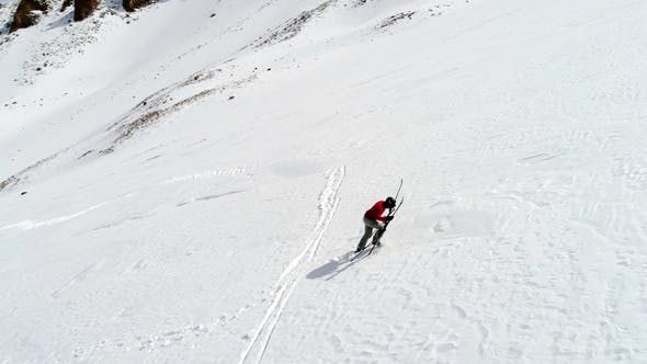 Cover Image for Skier Hiking Uphill