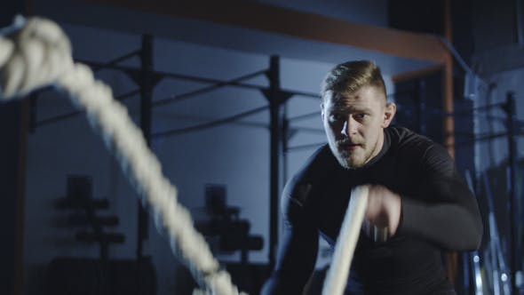 Thumbnail for Athlete Working Out with Heavy Ropes in Gym