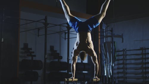 Athlete Working Out on Bars Training Stamina