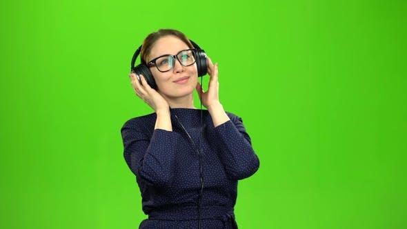 Thumbnail for Teacher Listening To Music on Headphones