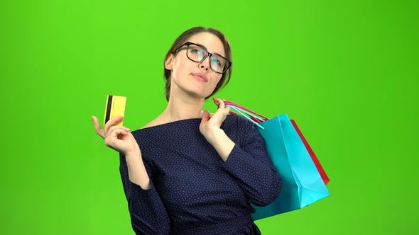 Thumbnail for Woman with Bags of Paper Goes Shopping with a Card in Her Hands