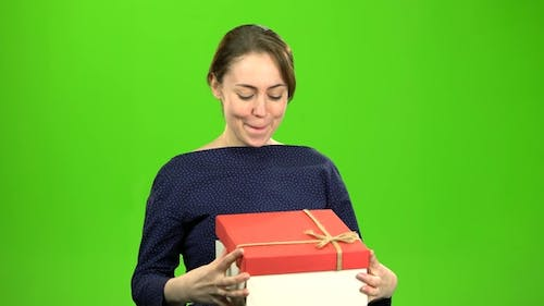 Girl Is Pleased with the Gift