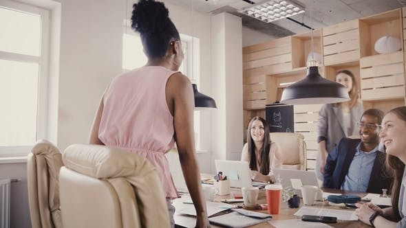 Thumbnail for Happy African American Businesswoman Talks To Friends in Modern Office. Multiethnic Young Colleagues
