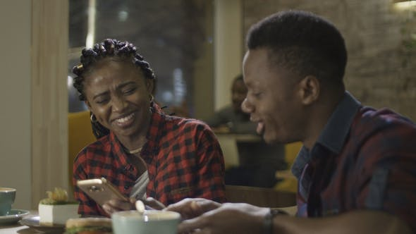 Thumbnail for Attractive Young Black Couple in a Cafeteria