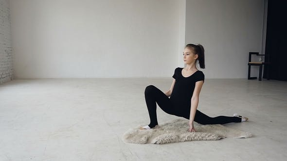 Thumbnail for Cute Teenage Girl Practices Stretching in a Modern Ballerina School. Professional Gymnastics