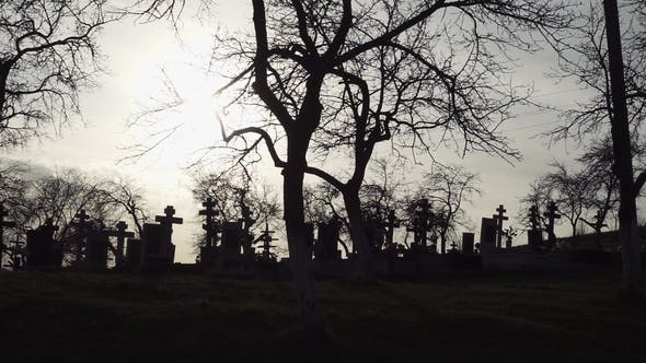 Thumbnail for Halloween Background. Old Graveyard with Ancient Crosses at Sunset