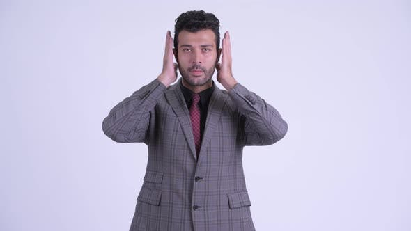 Thumbnail for Handsome Bearded Persian Businessman Doing Hear No Evil Concept