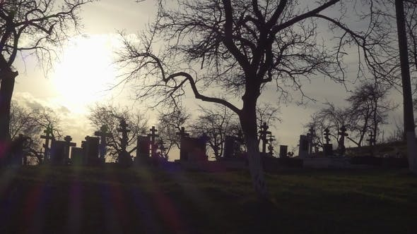 Thumbnail for Old Graveyard with Ancient Crosses at Sunset. Scary Cemetery