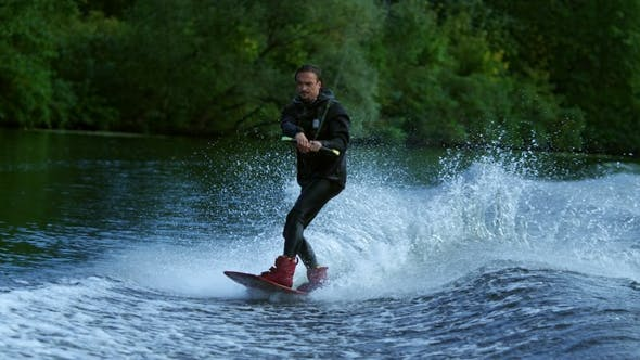 Thumbnail for Young Man Wakeboarding on River Wave. Wake Boarding Rider