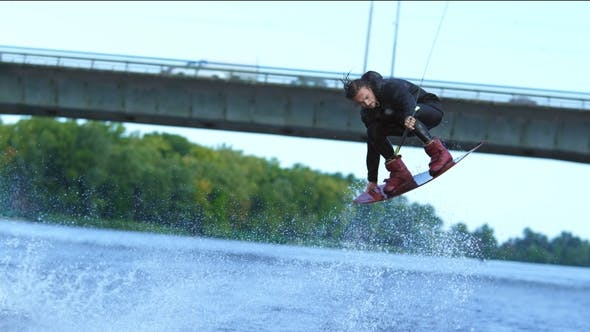 Thumbnail for Athlete Wakeboarder Jumping High Above Water. Extreme Stunt Over Water
