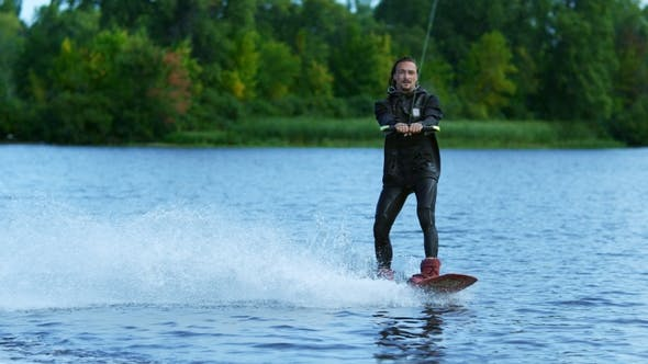 Thumbnail for Young Man Riding Wakeboard on Summer Lake. Man Enjoying Extreme Holidays