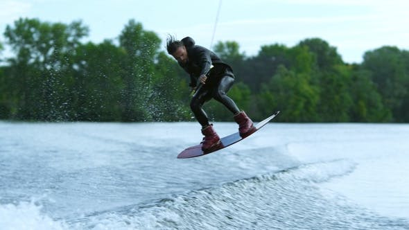Thumbnail for Wake Board Rider Jumping High Over water.Wake Surfing Rider on Water