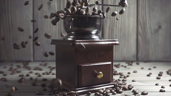 Thumbnail for Coffee Beans Fall in the Old Grinder.