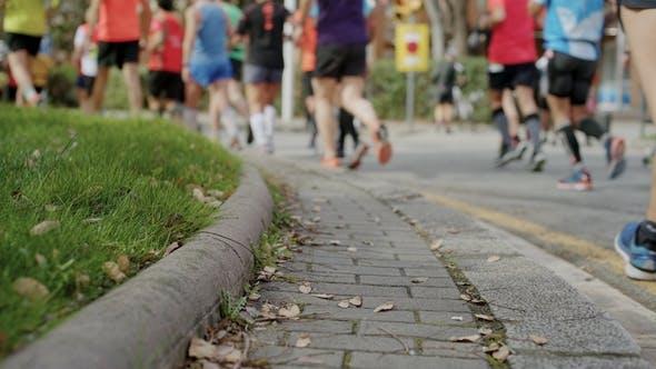 Thumbnail for Marathon Runners Unrecognizable on City Street