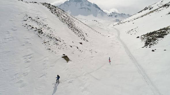 Thumbnail for Skier and Snowboarder in Peak Mountains