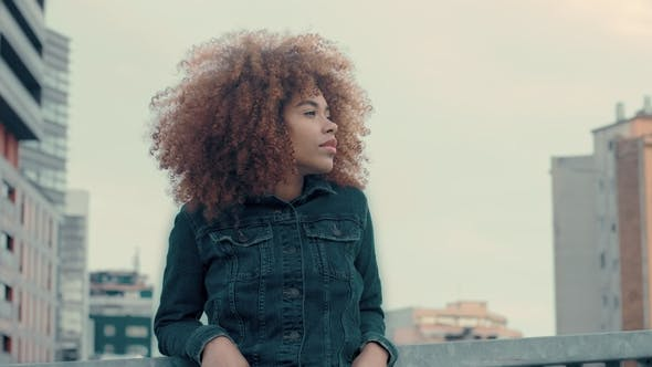 Thumbnail for Black Mixed Race Woman with Big Afro Curly Hair in Outdoor City