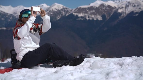 Thumbnail for Snowboarder Photographing in the Mountains