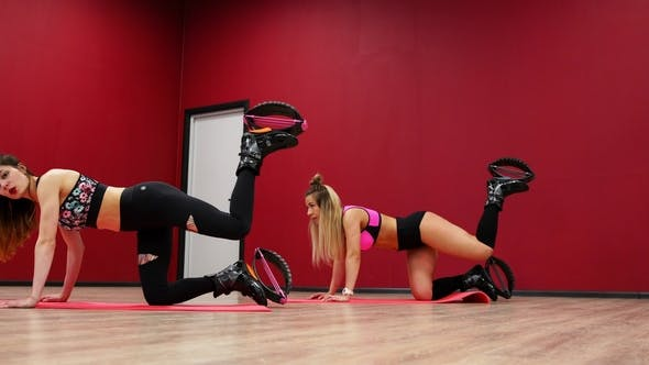 Thumbnail for Two Beautiful Sports Girls Perform an Active Fat-burning Workout Jumping Like a Kangaroo