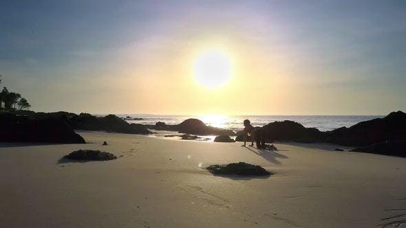 Thumbnail for Girl Silhouette Does Yoga on Beach against Sunrise