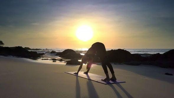 Thumbnail for Bright Sun Disk Lights Girl Figure Doing Yoga Beach