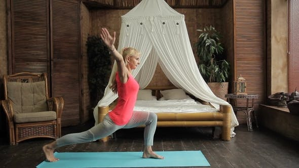 Thumbnail for Fitness Lady Performs Yoga Asanas in Bedroom at Home