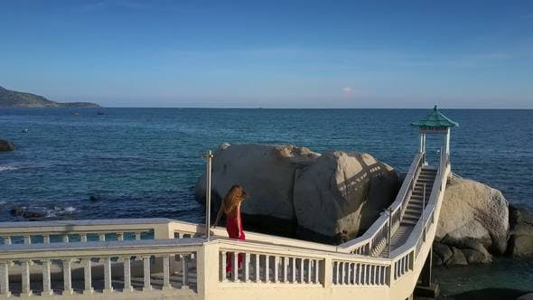 Thumbnail for Girl Goes down on Bridge against Stunning Seascape