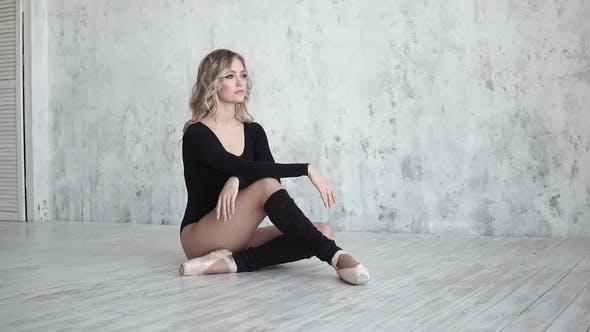Thumbnail for Portrait of a Ballet Dancer. Ballet Dancer in Black Bodysuit Sitting on the Floor