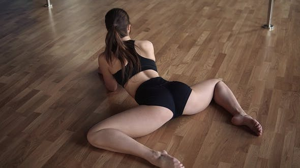 Thumbnail for Sexy Young Girl Athlete Stretched Before Exercising. Back View