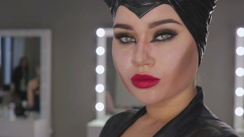 Make-up Artist Make the Girl Halloween Make Up in Studio