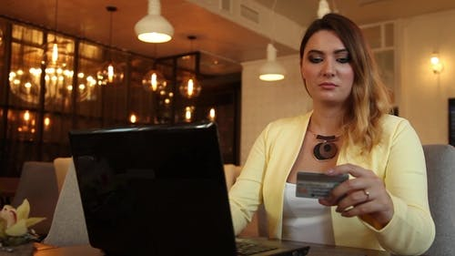 Business Woman in Business Clothes Commits Online Purchase Using a Credit Card