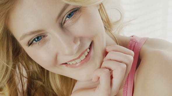 Thumbnail for of a Young Attractive Woman. Natural Lighting, Looking at the Camera and Smiling