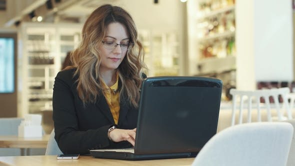 Thumbnail for Business Woman Working Behind Laptop