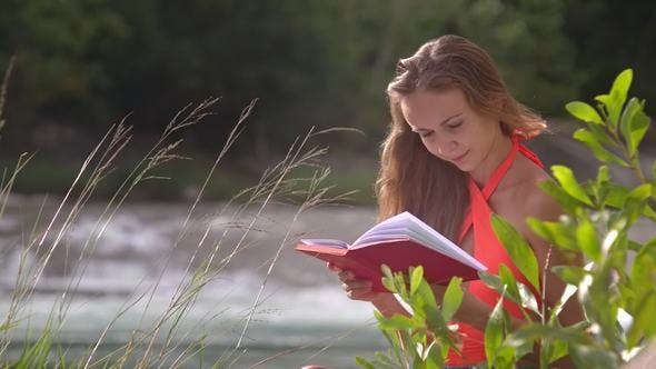Thumbnail for Sun Lights Girl Long Hair Reads Book on Windy Day