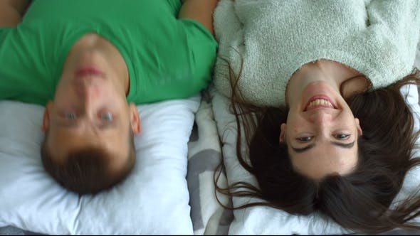 Thumbnail for Portrait of Attractive Couple Smiling in Bedroom