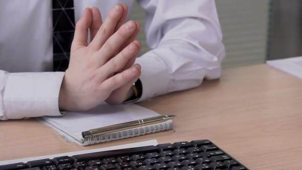 Thumbnail for Male Hands on Table at Business Negotiations in the Office