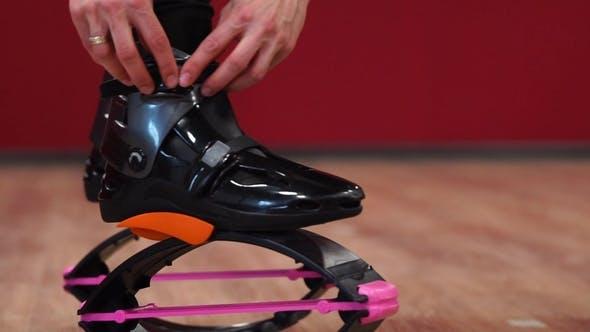Thumbnail for Sport Girl Holding Kangaroo Sports Shoes during Training