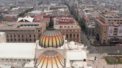 Drone Camera Flying Around Colorful Dome with Bird Sculpture of Palace of Fine Arts (Palacio De