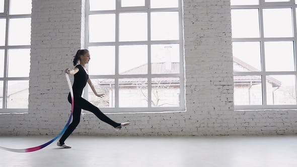 Thumbnail for Teenage Girl Performs Gymnastics Exercise with a Colored Ribbon