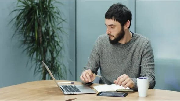 Thumbnail for Man Takes Notes From His Laptop To His Laptop
