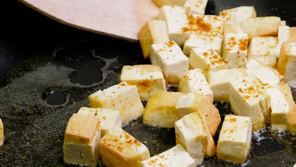 Thumbnail for Fried Tofu with Spices on a Cast-iron Pan, Healthy Ingredient for Cooking Vegetarian Dietary