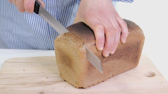 Female Hands Cutting Freshly Bread