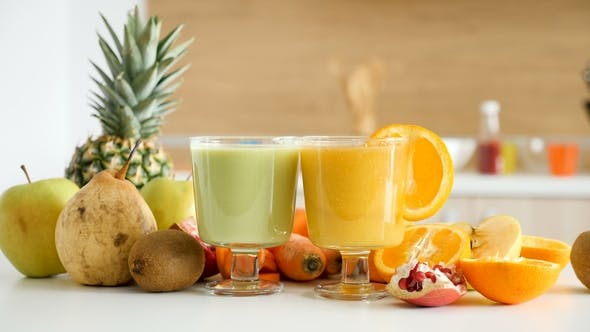 Two Glasses with Healthy and Organic Juices