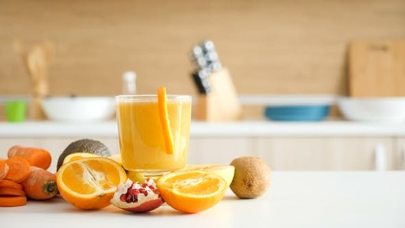 Thumbnail for Two Glasses with Healthy Detox Juice Lying on the Table