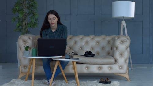 Freelance Woman on Sofa Suffering Headache at Home
