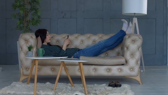 Thumbnail for Relaxed Woman Browsing Internet on Mobile Phone